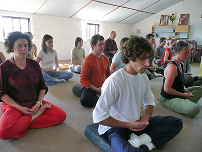 Students practising meditation in Portugal