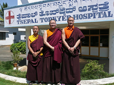 Ven. Lama Dondrup Dorje with hospital administrators